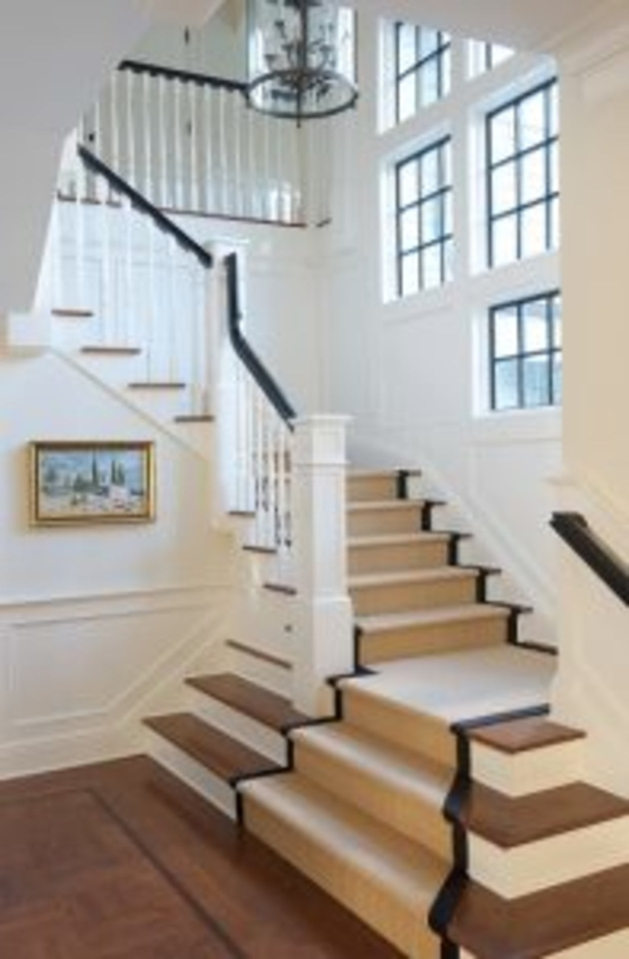 Architecture that Lets the Light In - foyer with two story windows